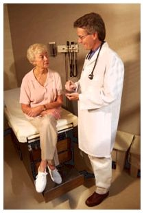 Photo: A doctor with a female patient